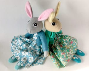 Two rabbit dolls in different colours