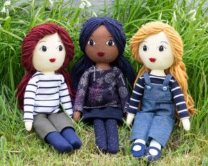 Tilly dolls with yarn hair in the garden